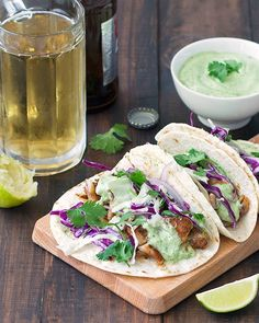 These blackened fish tacos come together in under 30 minutes and make a delicious weeknight meal. Spiced white fish is folded into warm tortillas, topped with shredded red cabbage and drizzled with a creamy avocado sauce.