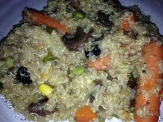 Healthy food Quinoa with vegetables chopped mushrooms, baby carrots and frozen peas put 2 cups of Quinoa and a hand full of other veg . Add all with three cups water in rice cooker with some fresh chives and pinch salt . Turn on and cook that's a quick vegetarian meal . 20 min .