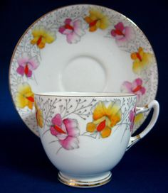 This is a Roslyn, England cup and saucer in a pattern called Sweet Pea made in the 1930s.