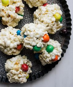 These colorful popcorn balls are so simple to make that the whole family will love to help out. When shaping the balls some of the M&Ms may pop out—but you can easily push them back in. Just take care to remove all the unpopped kernels from your popped corn before proceeding with the recipe.