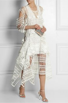 Chloé tiered crocheted lace dress * Crocheted cotton-blend lace * Cutout sleeves, tiered, georgette panels, split sides, asymmetric hem, slip to line * Button-fastening keyhole at back