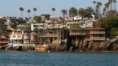 Newport Beach Harbor is a semi-artificial harbor that created several islands such as Newport Island, Balboa Island, Collins Island and more now mostly covered with private homes.