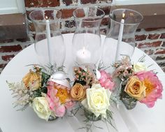 Beautiful unity candles for an outside wedding with hurricane glasses to help keep lit.
