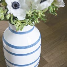 Fill the vase with pretty flowers to compliment its shape and colour.