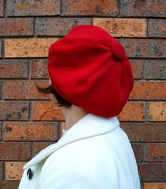 Tanith Rowan: Six panel red wool beret, refashioned from the sleeves of an old coat.