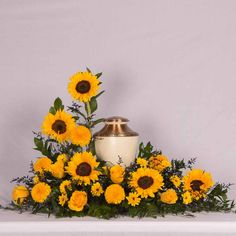Juts like how the urn is nestled. not necessarily the sunflower/yellow explosion Arrangements Funéraires, Sunflower Arrangements, Funeral Flower Arrangements, Funeral Flowers, Funeral Quotes, Funeral Urns, Sympathy Flowers, Wedding Order, Arte Floral