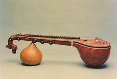 The Veena (Sanskrit: वीणा) is a plucked stringed instrument originating in ancient India, used mainly in Carnatic classical music and Hindustani classical music.