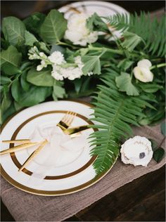 beautiful gold edged plates and cutlery