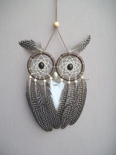 Here's a cute owl-inspired dream catcher with the use of two loops, beads and different feathers.