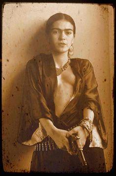 Photoshop hoax, or feisty femme?    #Frida #Kahlo #art #artist #icon #iconic #famous #sad #gun #pistol #naked #nude #paint #history #vintage #hoax #wow #stunning #unbelievable #photoshop #eyebrows #revealing #necklace #bohemian #boho #mexico #fake #?
