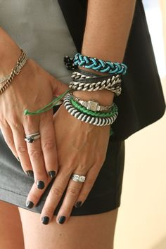 """Megan Maguire Steele, Owner of Maguire Steele   Where is each bracelet from? (from the hand upward)  Left arm:  """"Burkman Bros friendship bracelets (black and white, hunter green, and grass green)  Grandmother's watch  Carol Marie chain and leather wrap bracelet  Timo Weiland for Roarke NYC bracelet""""    Right arm:  """"Grandfather's US Navy ID bracelet circa WWII  Diamond bracelet from my mom and dad for my 30th birthday"""""""