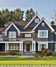 love all the detail lines of this homes exterior windows stone porch columns - Exterior Color Design