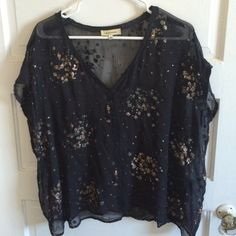 """Costume national silk glitter blouse Beautiful designer blouse from Italian brand Costume national. Black silk with inside-put seaming and literal chunks of glitter everywhere. Sold as is as there is  1"""" rip trough the shirt on both front and back. No idea how this happened but could be mended. Blousy but arm holes would fit only up to a size large if that. Costume National Tops Blouses"""