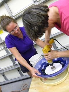 Turning a student's fused glass vessel into a sink at the September 2014 Sink Class with Lisa Vogt