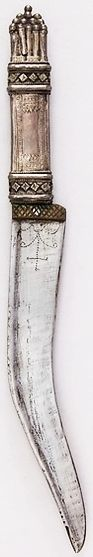 Arabian shafra knife, 18th to 19th century, steel, silver, brass Dimensions: H. 12 in. (30.5 cm); H. of blade 7 3/8 in. (18.7 cm); W. 1 3/16 in. (3 cm); Wt. 6.2 oz. (175.8 g), Met Museum, Bequest of George C. Stone, 1935.
