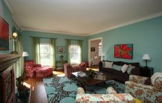John Krasinski and Emily Blunt's living room. i like how mismatched, yet cohesive it is. oh, and the colors. :)