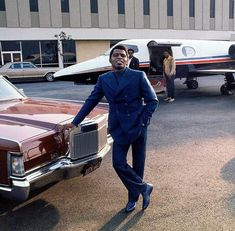 James Brown standing near his Lincoln and private jet at the airport. James Joseph, Young Johnny Cash, Full Moon Pictures, Sly Stone, George Clinton, Apollo Theater, Augusta Georgia, Custom Caps, Photoshoot Concept