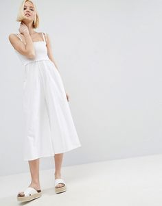 Get this Asos's long jumpsuit now! Click for more details. Worldwide shipping. ASOS Jumpsuit in Cotton with Shirred Bodice - White: Jumpsuit by ASOS Collection, Lightweight cotton, Bandeau neckline, Tie straps, Shirred-stretch bodice, Wide-cut leg, Regular fit - true to size, Machine wash, 100% Cotton, Our model wears a UK 8/EU 36/US 4 and is 175cm/5'9 tall. Score a wardrobe win no matter the dress code with our ASOS Collection own-label collection. From polished prom to the after party, our…