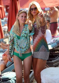On point: the blonde models made a striking pair together on the beach...