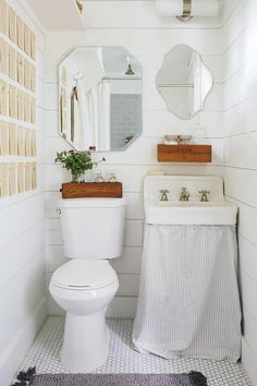 Shelf upper left of shot. Last thing you notice. But great storage in a powder room with a pedestal.