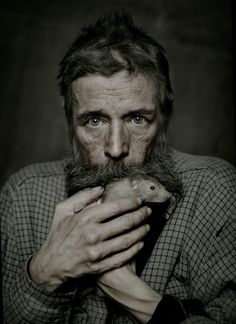 by Magnus Wennman, old guy, beard, rat, hands, storyteller, powerful face, intense eyes, strong, emotional, expression, portrait