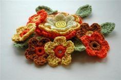 Crochet Applique Flowers in Yellow Orange Fall shades.