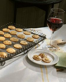 Cheese Coins - I made these with manchego cheese and served them with quince jelly. The dough freezes beautifully.