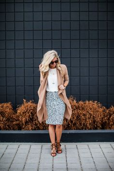 The perfect summer to fall look in a printed pencil skirt and cognac sweater.