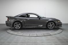 HIGHLIGHTS * car that's logged only miles * 1 of 128 coupes built for the 2003 model year / 1 of 15 decked in gray-on-gray. Ford Mustang Saleen, 2003 Ford Mustang, Mustang Cobra, Ford Gt, My Lil Pony, Performance Cars, Modified Cars, Helicopters, My Ride