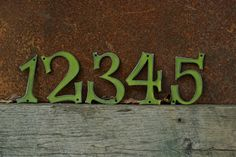 Just ordered these custom house numbers. LOVE THEM! Leaf green color says spring all over.