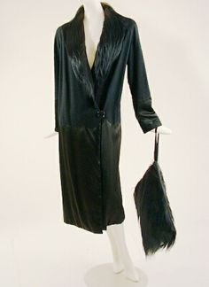 Black Monkey Fur Trim Coat and Muff   Probably French, late 1920s   The calf length wrap with button at hip, the upper portion of black wool, the lower of black satin with scallop edge, size 6, with monkey fur collar and muff.