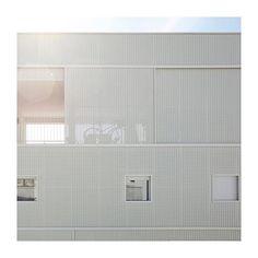 Carré Lumière in Bègles, Bordeaux, France by LAN Architecture #architecture #design #residentialdesign #apartmentdesign #communityhousing #sustainabledesign #whitemetal #facade #perforatedmetal #minimalist #simplicity #minimaldesign #light #carrélumière #bègles #bordeaux #france #lanarchitecture