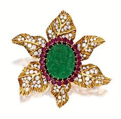 Carved Emerald Ruby and Diamond Flower brooch by Cartier - Sotheby's. See other examples here.  http://collectingvintagejewelry.blogspot.com/2013/03/sothebys-goes-green-with-jewels-and.html
