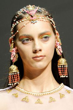 A model at Paris fashion week with hair accessories and earrings from the Manish Arora Amrapali collection.