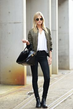 Brown bomber jacket + white blouse + skinny jeans and black handbag
