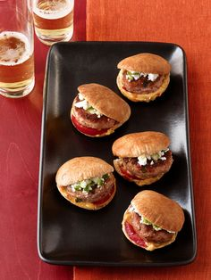 Turkey-Hummus Sliders : Served in pita pockets and flavored with hummus, these leaner turkey sliders offer a Mediterranean take on the mini-burger. For added crunch and flavor, each one is topped with a cucumber-feta salad.