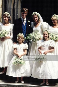 Bride and groom Julia Rawlinson and James Ogilvy pose with their bridesmaids (L-R) Charlotte Rawlinson, Lady Gabriella Windsor, Alexandra Wilson And Eleanor Rawlinson during their wedding at St. Mary The Virgin Church on July 30, 1988 in Saffron Walden, England.