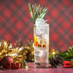 Holly Jolly 1.5 oz Gin .5 oz Pine Liqueur .75 oz Vanilla Syrup .75 oz Lime Juice 3 Mint Leaves Soda, for topping Pine needles, for garnish
