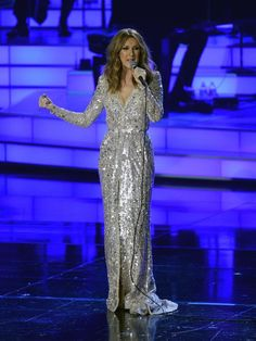 Celine Dion in a silver embellished floor length gown by Zuhair Murad.