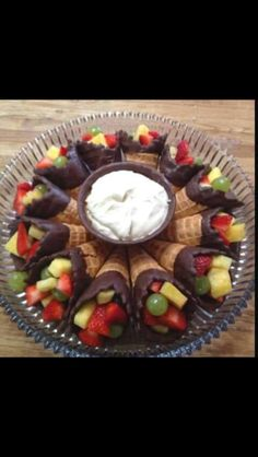 Fruit cones! Dip in chocolate and add your filling. Great idea for a summer BBQ! (salad presentation display)
