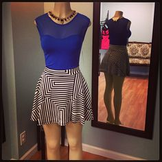 # Blue mesh stretch top and cute blk and white striped scuba skirt.