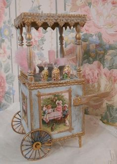miniature cotton candy cart shared by Ʈђἰʂ Iᵴɲ'ʈ ᙢᶓ Diy Doll Miniatures, Miniature Dolls, Miniature Furniture, Dollhouse Furniture, Carousel Cake, Sweet Carts, Candy Cart, Tea Cart, Flower Cart