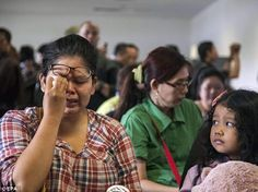 Family and friends have gathered at Juanda Airport in Surabaya, Indonesia, to learn about their loved ones onboard the missing flight.AirAsia flight QZ8501 disappeared while en route to Indonesia on Sunday morning