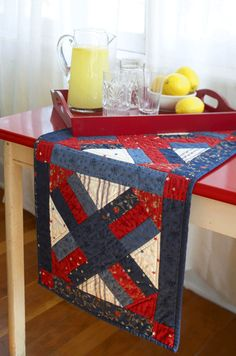 Make a simple three-block table runner using Rail Fence units, triangles, and squares.