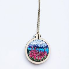 Embroidery mini hoop necklace, landscape, lupines, by Stitch Dreams Embroidery Hoop Art, Cross Stitch Embroidery, Embroidery Patterns, Antique Jewelry, Vintage Jewelry, Polymer Clay Jewelry, Clay Crafts, Pendant, Mini