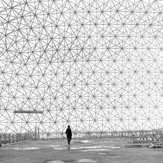 A photograph of Joseph Beuys in Buckminster Fuller's iconic geodesic dome of the Expo 67 pavilion on Montreal's Île Sainte-Hélène.
