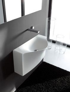 Back, design Meneghello Paolelli Associati. RED DOT DESIGN AWARD 2011.  Compatto e di profonditá davvero minima, il lavabo Back é presentato nelle due versioni da parete, a terra  o sospesa. In Livintec / Compact and very little depth, the washbasin Back is presented in two versions: back to wall or wall-hung. In Livingtec. #bathroom #sink #washbasin #design #bagno #lavabo