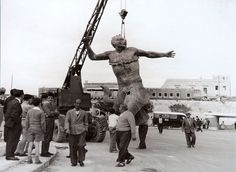 A photo taken during the installation of the Triton Fountain just outside City Gate in 1959.