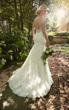 Essense of Australia's exquisite tulle fit-and-flare wedding dress boasts beautiful cap lace sleeves and peek-a-boo back detailing.