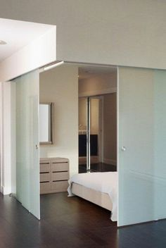 ceiling mounted sliding glass doors.